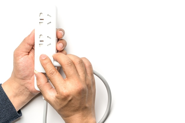 Man hand plugging the electric power socket bar white color