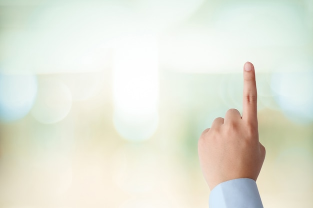 Man hand touching over blur office background, business background, banner