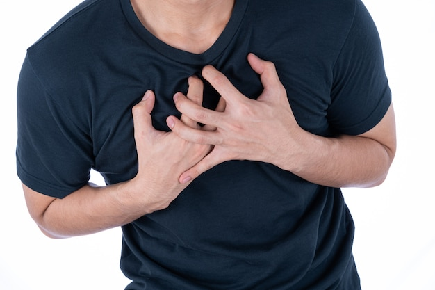 Man hand touching chest pain isolated on white