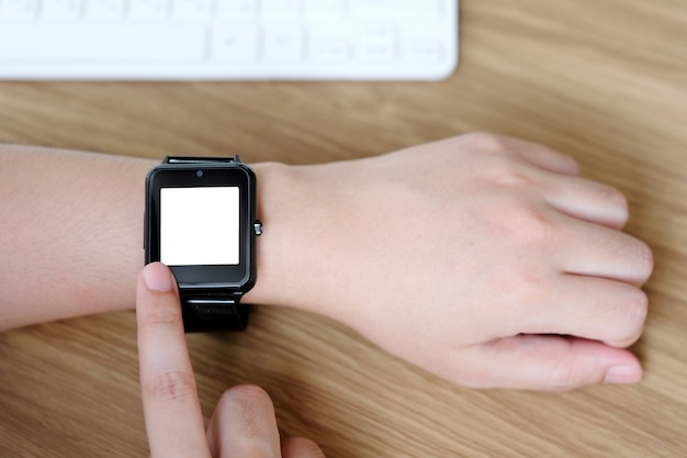 Man hand touching smartwatch with blank on screen, mock up, template, technology lifestyle