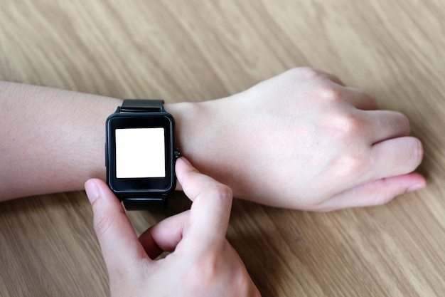 Man hand touching smartwatch with blank on screen, mock up, template