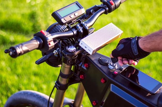 Man hand turning ignition key on ebike