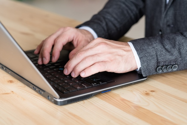 Man hand typing on laptop. remote job and online business. freelance work.