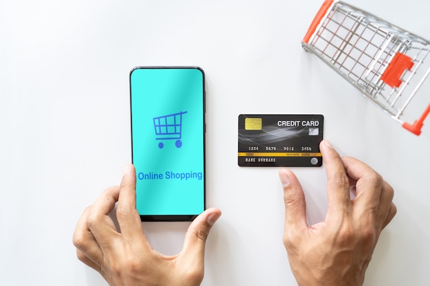 Man hand using mobile smartphone and credit card. shopping online