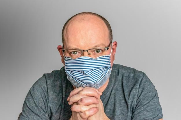 Man in a handmade medical mask. lack of masks.