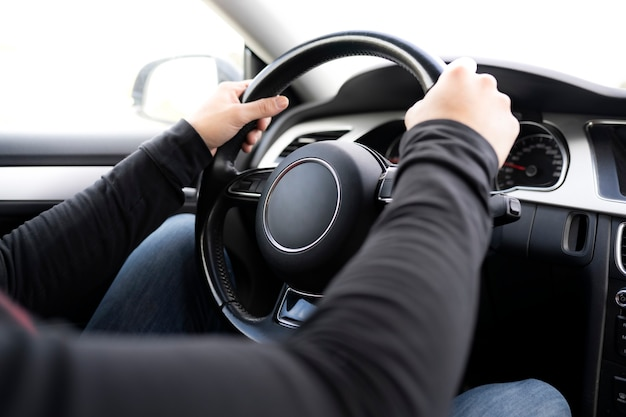 Man hands driving steering wheel