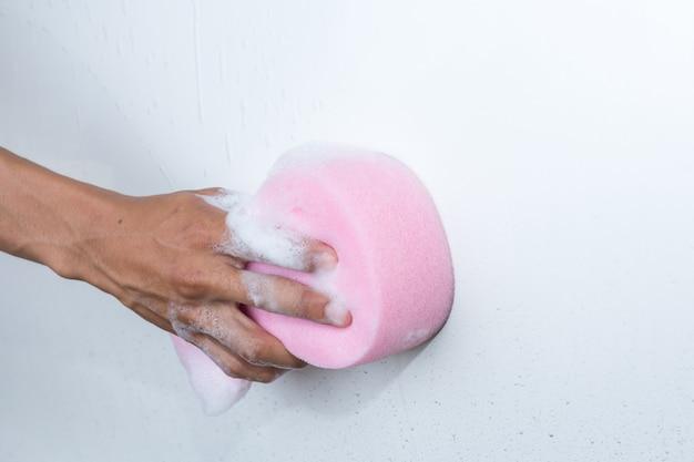 Man hands hold sponge for washing  white car