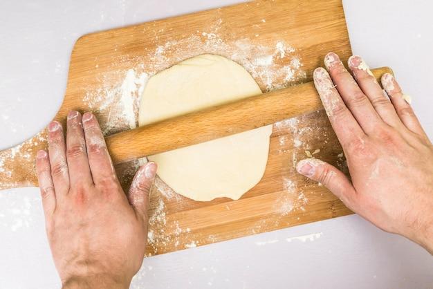 Man hands rolled dough