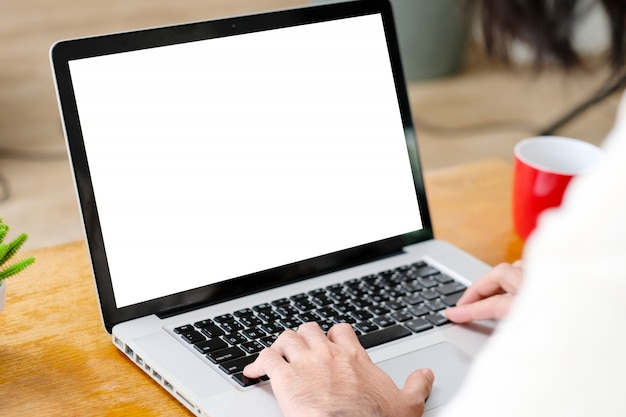 Man hands using laptop computer with blank screen for mock up template background, business technology and lifestyle background concept