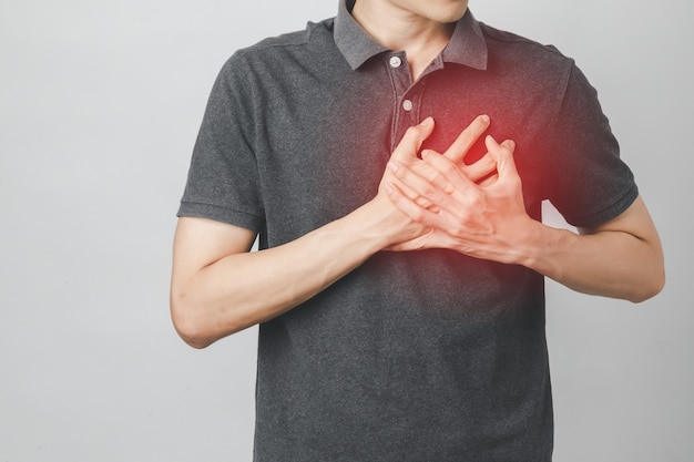 Man has chest pain suffering by heart disease, cardiovascular disease, heart attack. health care concept.