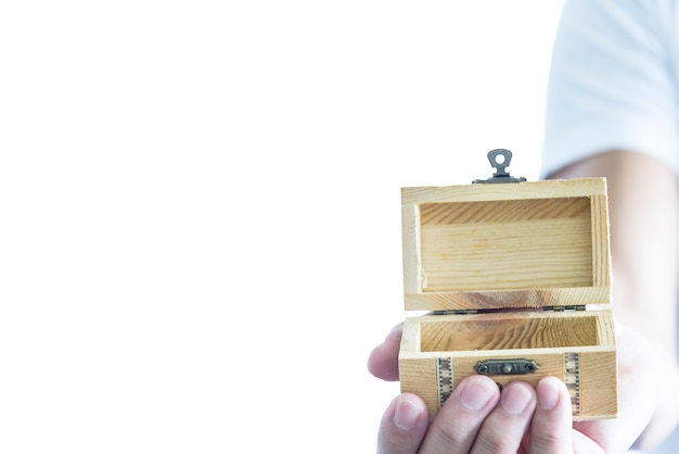 Man has give a surprise present with empty wooden treasure