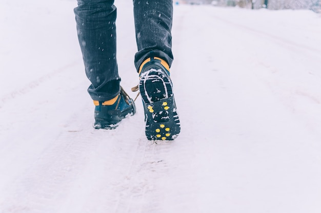 The man has ice shoes on his shoes.