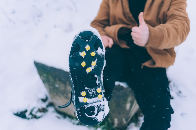 The man has ice shoes on his shoes