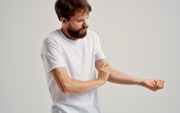 A man has pain in his hand wrist elbow muscle atrophy