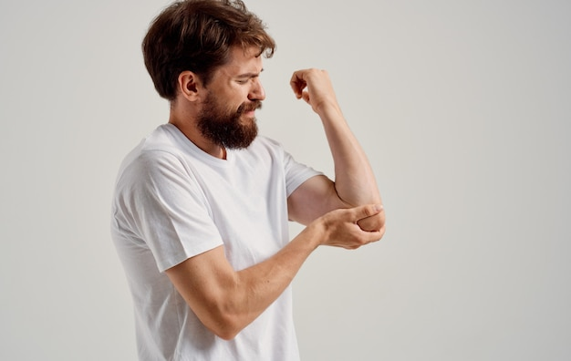 A man has pain in his hand wrist elbow muscle atrophy.