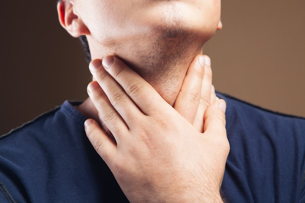 The man has a sore throat