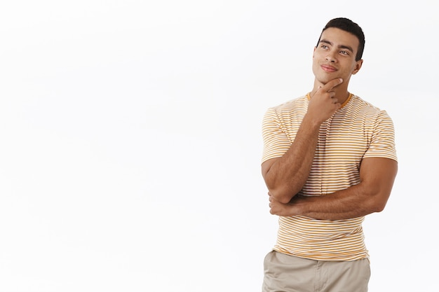Man have interesting idea. handsome masculine young guy, rubbing chin thoughtful
