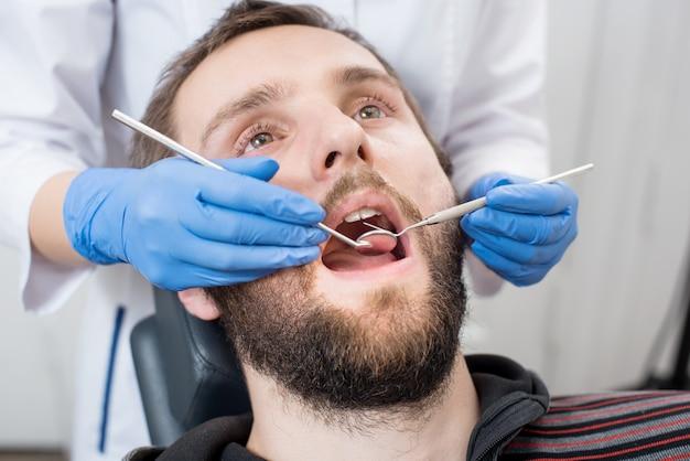 Man having dental check up in dental clinic