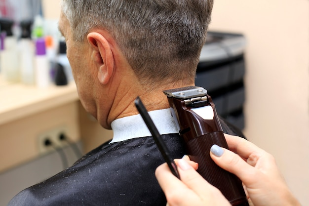 Man having a haircut from hairdresser
