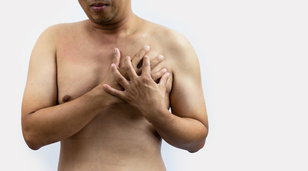 Man having heart-attack  chest pain in isolated background