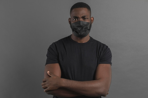 Man having his arms crossed and wearing mask