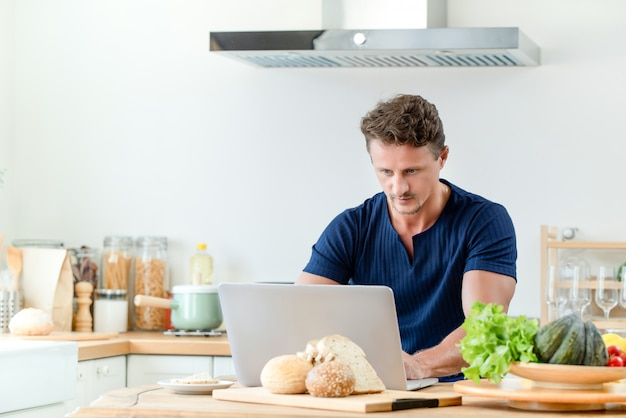 Man having online chatting and working from home
