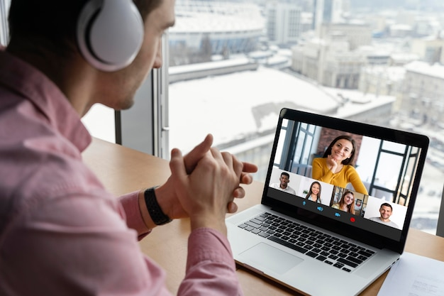 Man having an online video call with coworkers