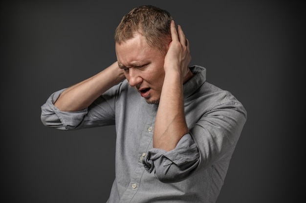 Man having panic attack on dark surface