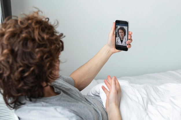 Man having a video call with a doctor