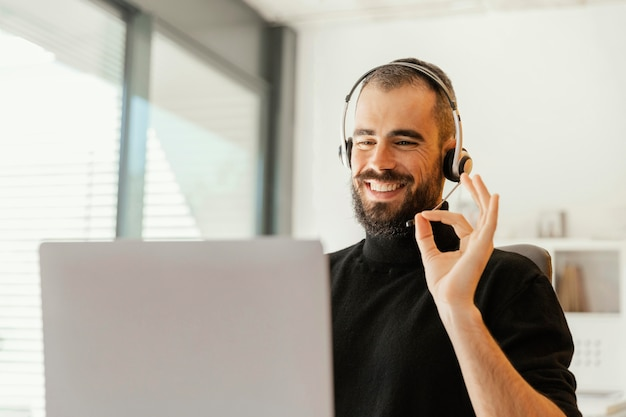 Man having a videocall for work Free Photo