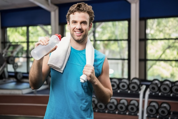 Man having water after workout