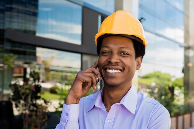 Man in helmet talking on the phone