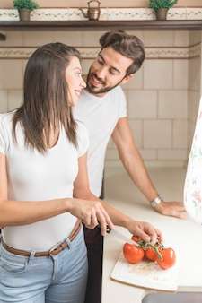 Man helping girlfriend with cooking