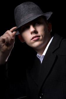Man hiding behind his hat