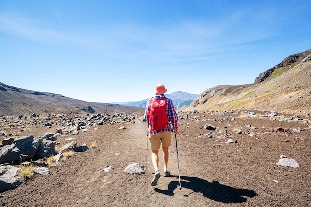Man in hike in volcanoes region (araucania) in chile, south america