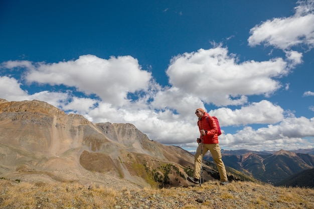 Man hiking in the rocky mountains, colorado in autumn season