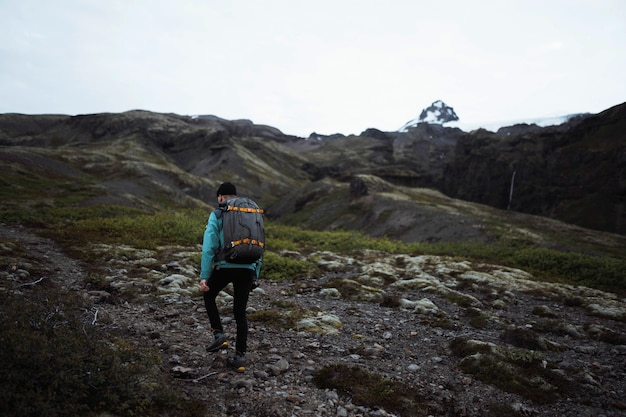 Man hiking at the south coast of iceland
