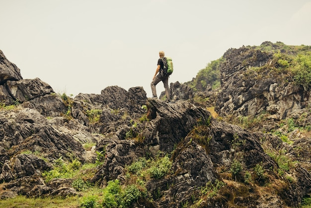 Man hiking with backpack high in vietnam