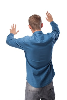 Man on his back with his hands up