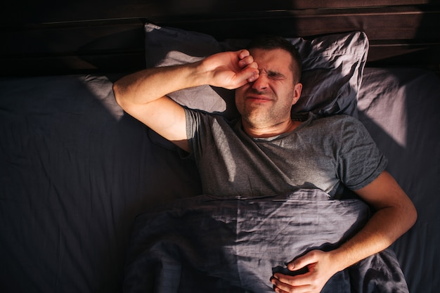 A man in his bed in the morning