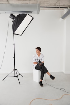 Man in his professional photography studio