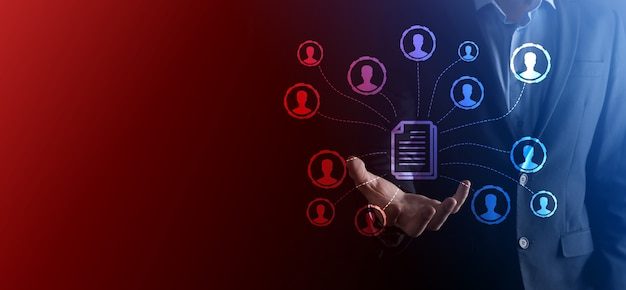 Man hold document and user icon.corporate data management system dms and document management system concept. businessman click or publish on document connected with corporate users.