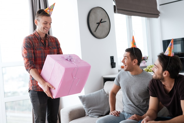 Man hold giftbox . guys spend time together .