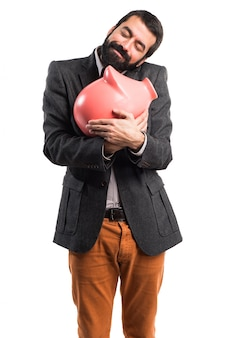 Man holding a piggybank
