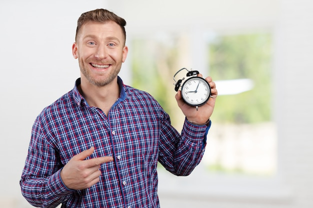 Man holding an alarm clock