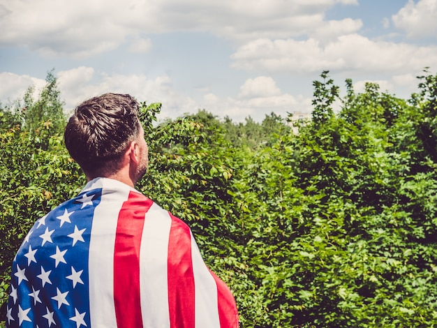 Man holding an american flag . national holiday
