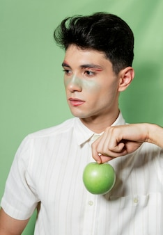 Man holding apple in pose