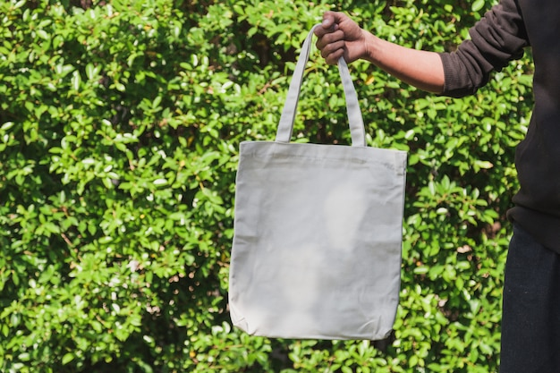 Man holding bag canvas fabric for mockup,ecology concept.