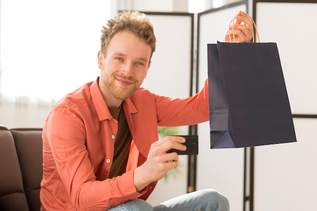 Man holding bag and credit card