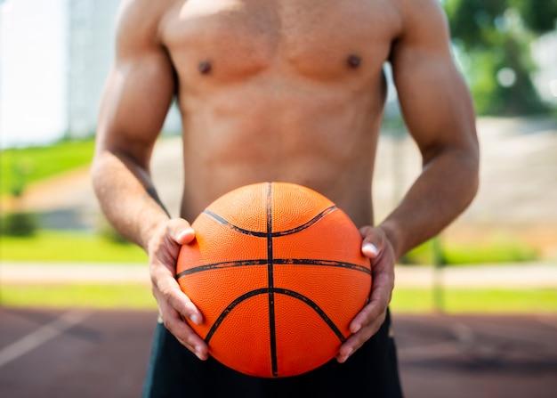 Man holding a ball medium shot